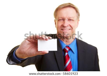 Senior businessman holding a white business card - stock photo