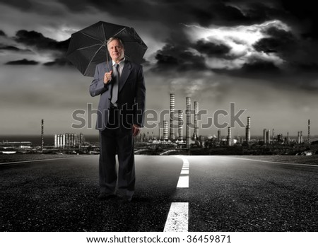 senior businessman holding umbrella under a toxic rain