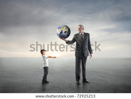 Senior businessman lending the earth to a child