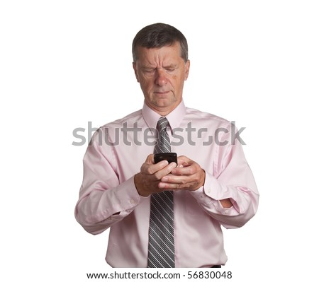 Senior businessman making a telephone call on a blackberry type device