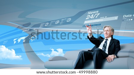Senior businessman navigating news interface in future (outstanding business people in interiors / interfaces series)