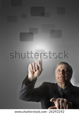 senior businessman pressing a touchscreen button