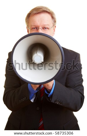 Senior businessman screaming loudly in a big megaphone