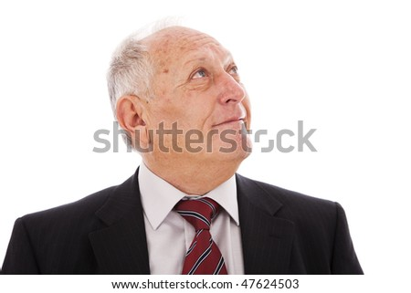 Senior businessman smiling and looking to the copy space (isolated on white) - stock photo