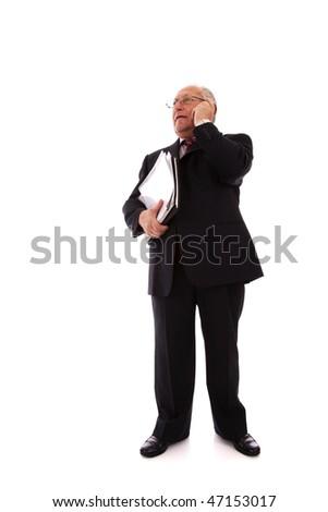 senior businessman talking on his cellular (isolated on white)