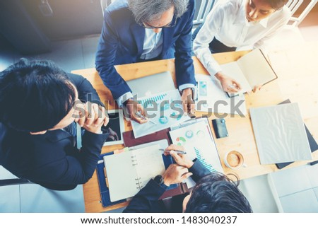 Senior businessman using hand gesture while explain business plan and discussion in the meeting. Selected focus