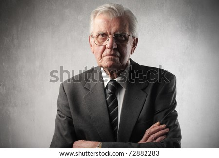 Senior businessman with angry expression