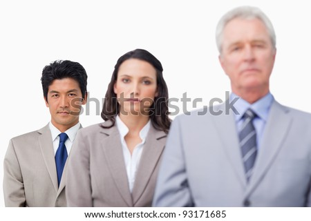 Senior businessman with his employees against a white background