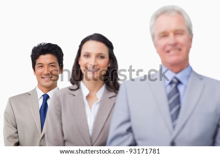 Senior businessman with his team against a white background