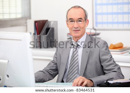 Senior businessman working at a computer