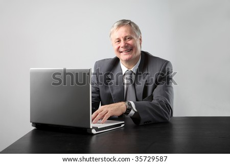 senior businessman working with laptop