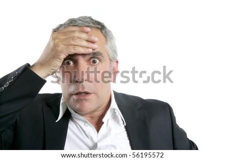 senior businessman worried expression hand in head gray hair