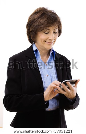 Senior businesswoman using mobile phone, writing email or text message. Isolated on white background.