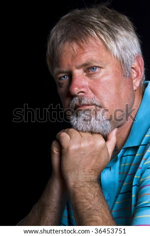 Senior caucasian man with blue shirt