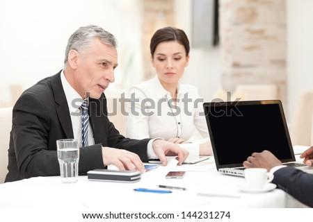 Senior CEO having staff meeting in restaurant