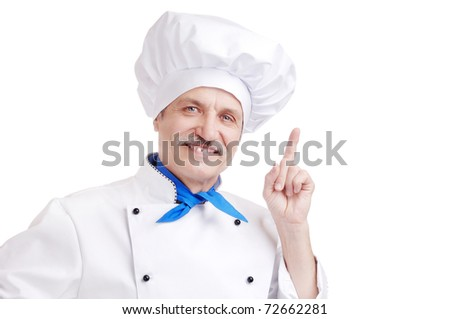 Senior chef in white uniform   making a gesture with his hand