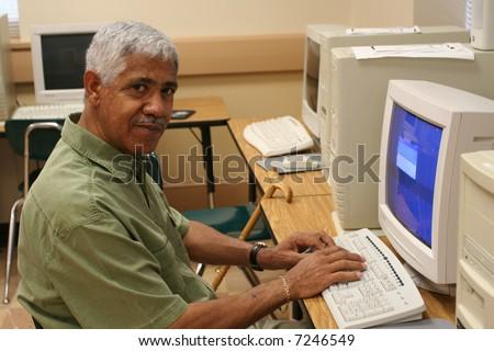 Senior citizen learning computer skills