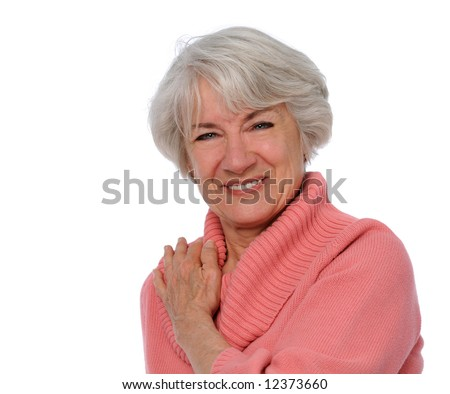 Senior citizen smiling isolated over a white background