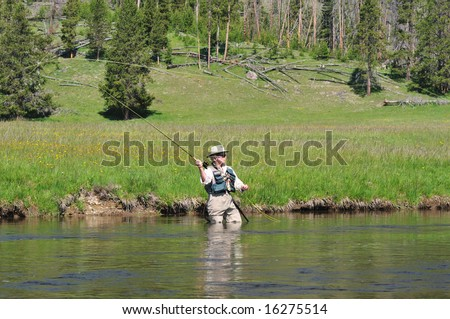 Senior citizen standing in the firehole river in for Do senior citizens need a fishing license