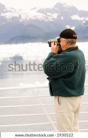 Senior citizen with videocamera at Alaskan cruise