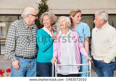 Senior citizens and geriatricians laugh happily in the nursing home or nursing home