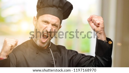 Senior cook man, wearing chef hat happy and excited celebrating victory expressing big success, power, energy and positive emotions. Celebrates new job joyful #1197168970