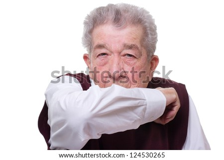 Senior coughs and holds the arm in front of the mouth
