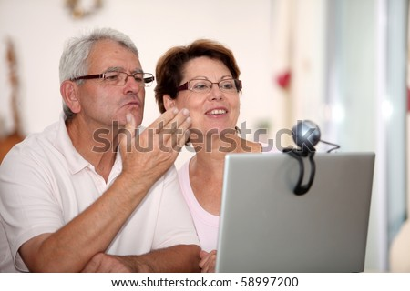 Senior couple and video call