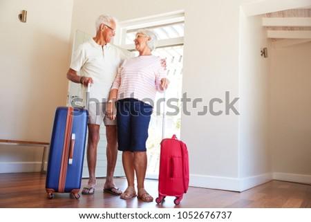 Senior Couple Arriving At Summer Vacation Rental #1052676737