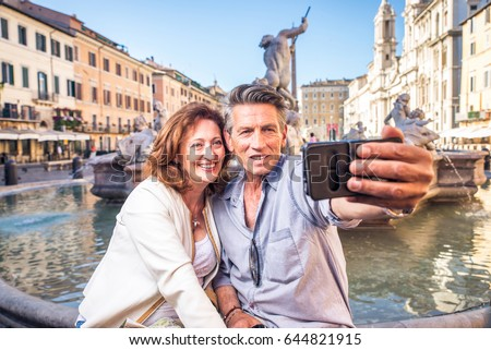 Senior couple at Navona square, Rome - Happy tourists visiting italian famous landmarks #644821915