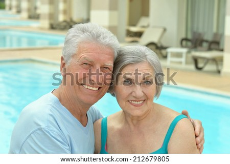 Senior couple by pool at the resort during vacation #212679805