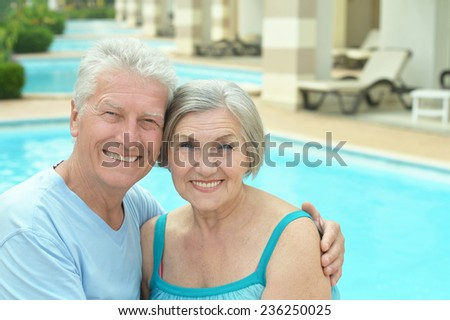 Senior couple by pool at the resort during vacation #236250025