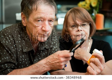 Senior couple closely examining instructions on prescription medications