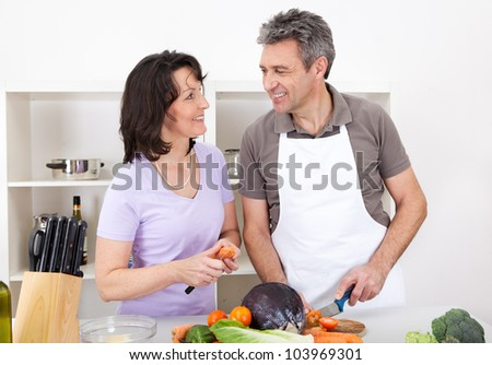 Senior couple cooking lunch at home. Isolated on white