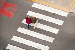 Senior couple crossing the road on a  crosswalk