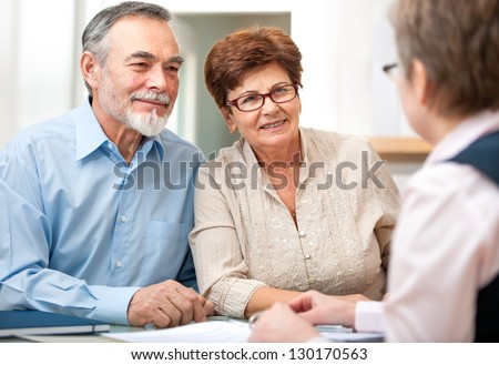 Senior couple discussing financial plan with consultant