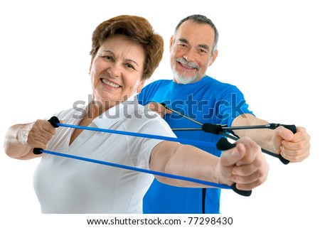 senior couple doing exercises with a resistance band