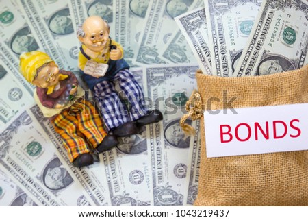 Senior couple doll with word BONDS and Savings Dollar banknote money in sack. Show growth asset investment, Retirement plan, Pension fund, 401K, Wage, Millionaire, Financial freedom, Wealth concept.