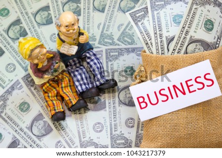 Senior couple doll with word BUSINESS and Savings Dollar banknote money in sack. Show growth asset investment, Retirement plan, Pension fund, 401K, Wage,Millionaire, Financial freedom, Wealth concept.