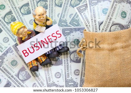Senior couple doll with word BUSINESS and Savings Dollar banknote money in sack. Show growth asset investment, Retirement plan, Pension fund and 401K, Millionaire, Financial freedom, Wealth concept.