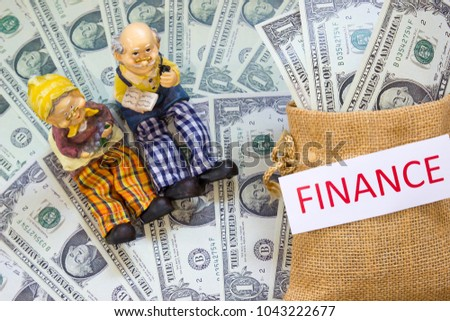 Senior couple doll with word FINANCE and Savings Dollar banknote money in sack. Show growth asset investment, Retirement plan, Pension fund, 401K, Wage, Millionaire, Financial freedom, Wealth concept.