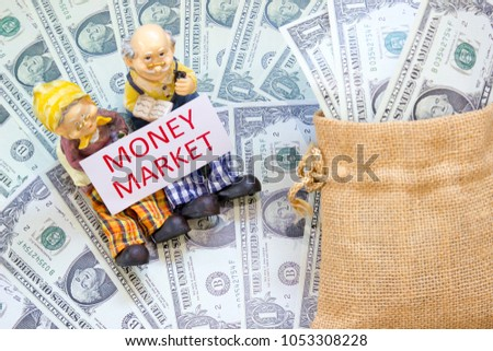 Senior couple doll with word MONEY MARKET and Savings Dollar banknote money in sack. Show asset investment, Retirement plan, Pension fund and 401K, Millionaire, Financial freedom, Wealth concept.