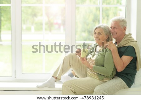 Senior couple drinking tea at home  #478931245