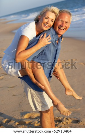 Senior Couple Enjoying Beach Holiday