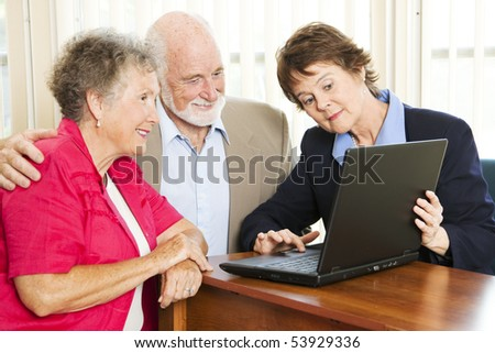 Senior couple getting financial advice or a sales pitch.