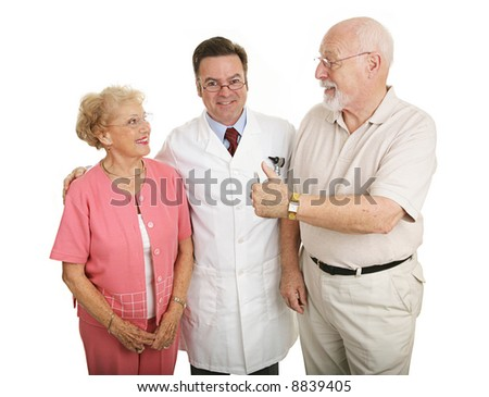 Senior couple giving a thumbs-up to their eye doctor after a successful office visit.  Isolated on white.