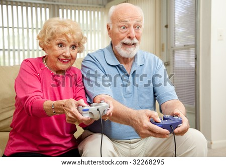 Senior couple having a great time playing video games.