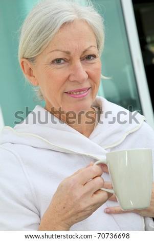 Senior couple having breakfast outside