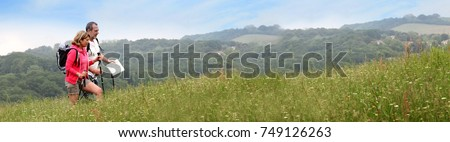 Senior couple hiking in natural landscape - banner template web