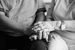 Senior couple holding hands together